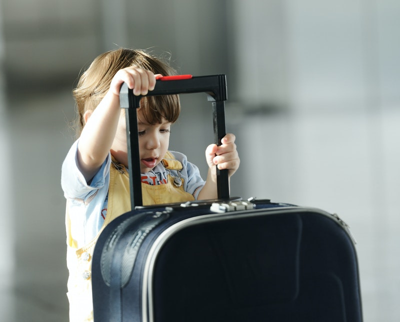 1481389780 little cute baby with bag on airport traveling bkp3cqaso