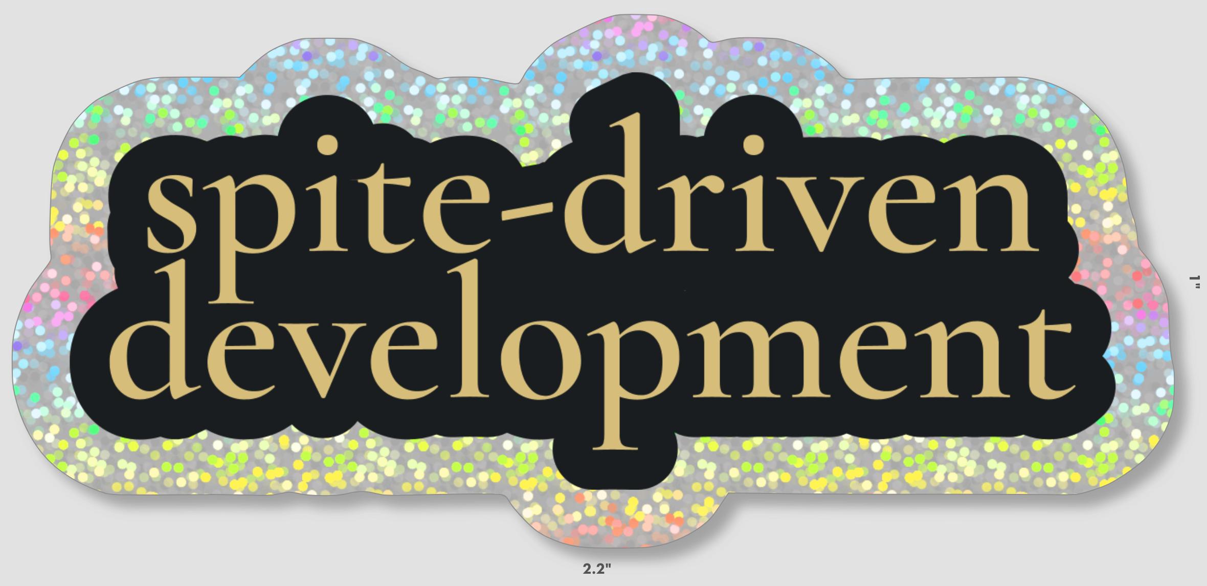 spite-driven development in gold serif font on black outline with larger sparkly outline