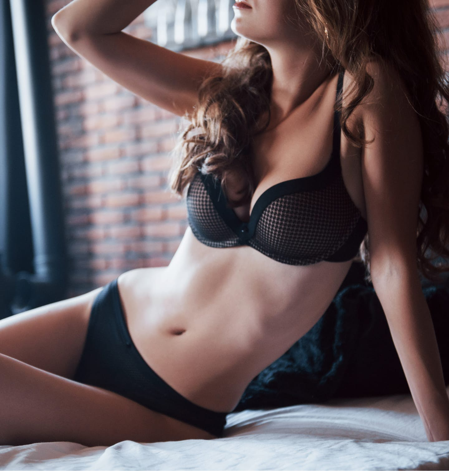 Hot model laying in bed wearing lingerie