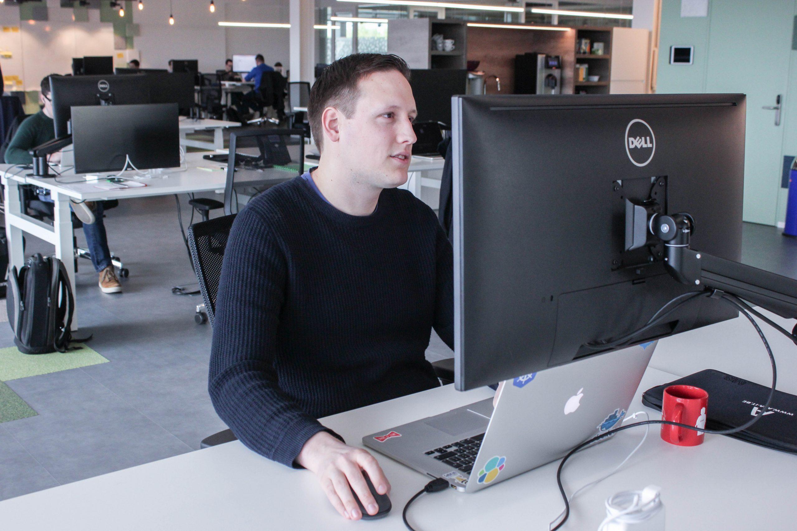 ACA employee at laptop - developing for Medi-Market