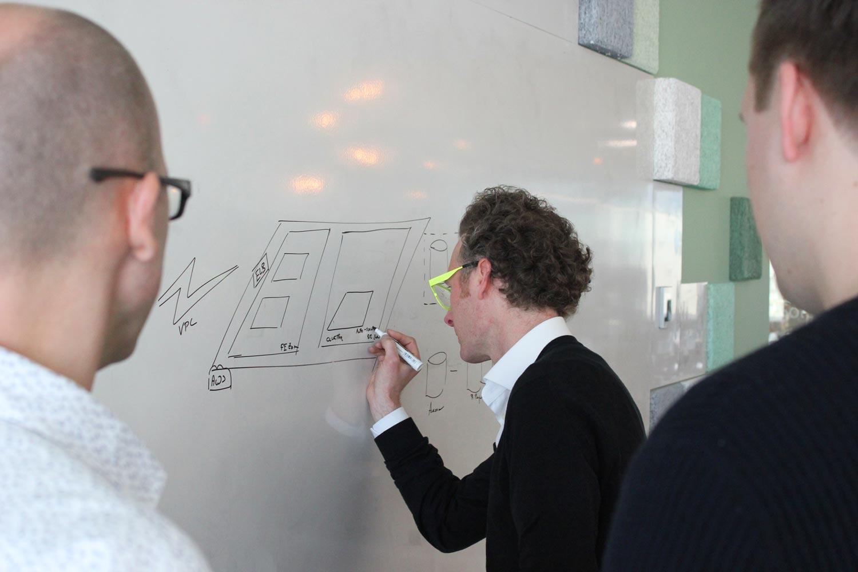 cloud team member Stijn Van den Enden writing on whiteboard