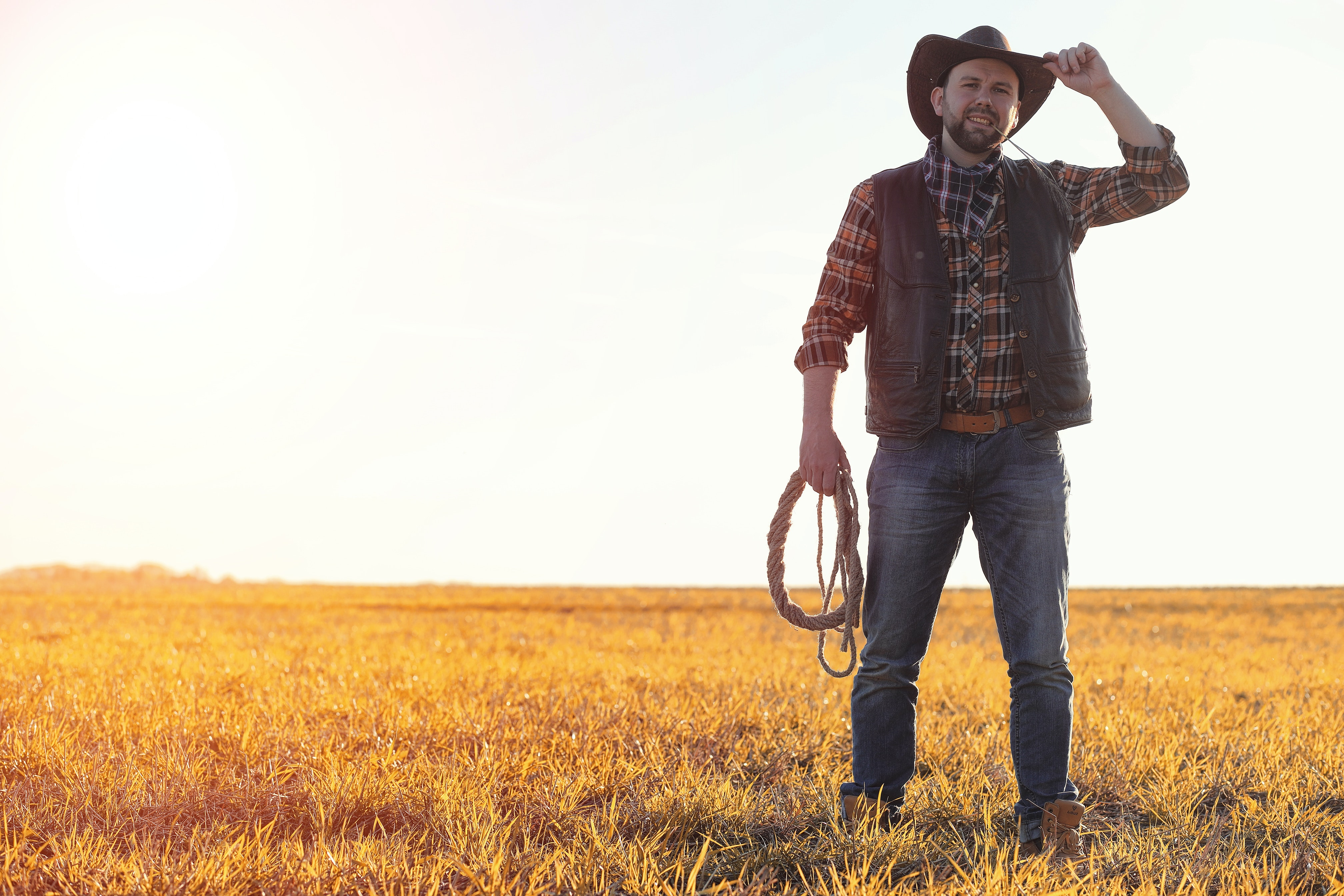 How to install Rancher RKE2 on CentOS Stream 8 blog post hero image, cow boy standing in field with lasso