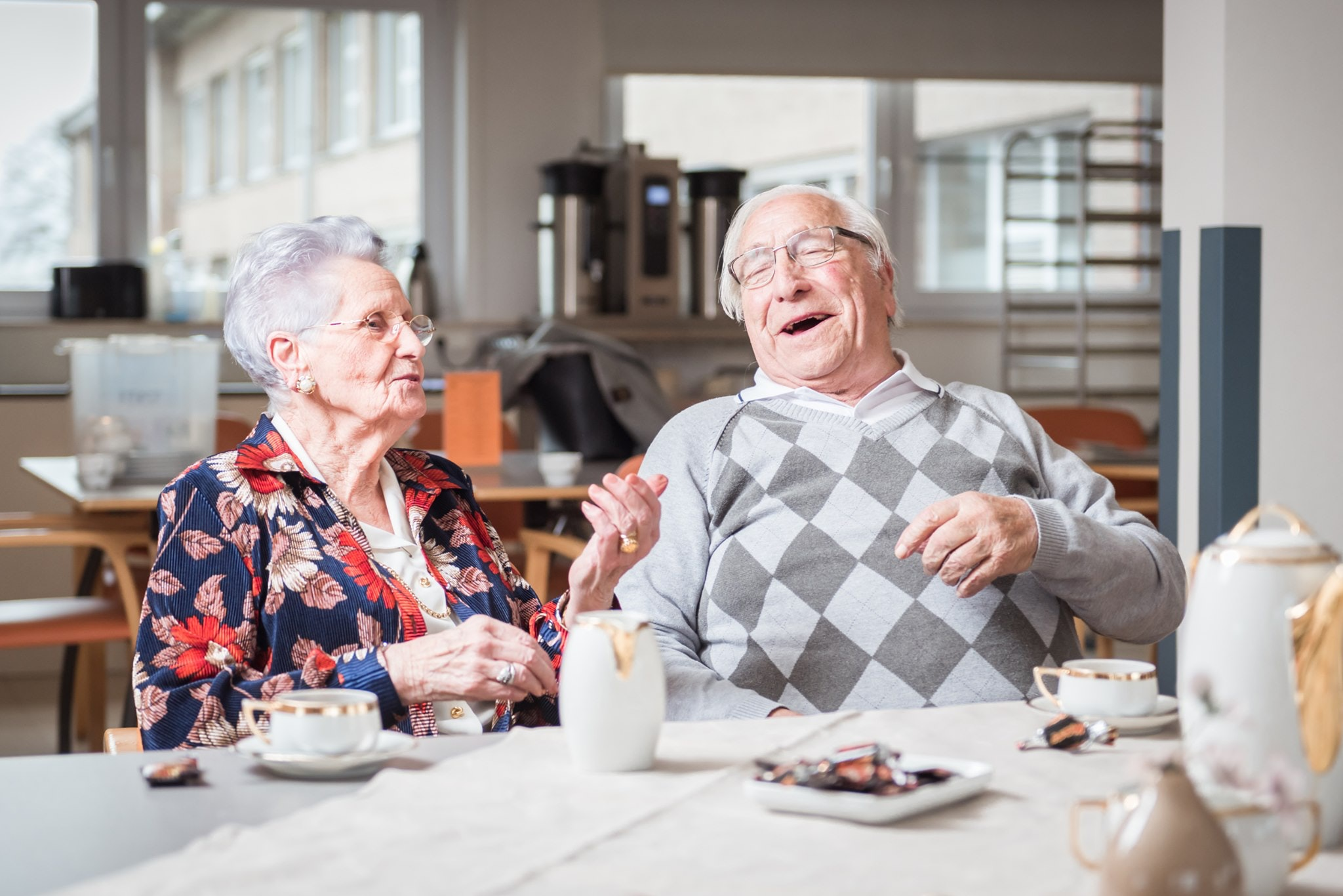 Motena hero image, two elderly people enjoying care in nursery home