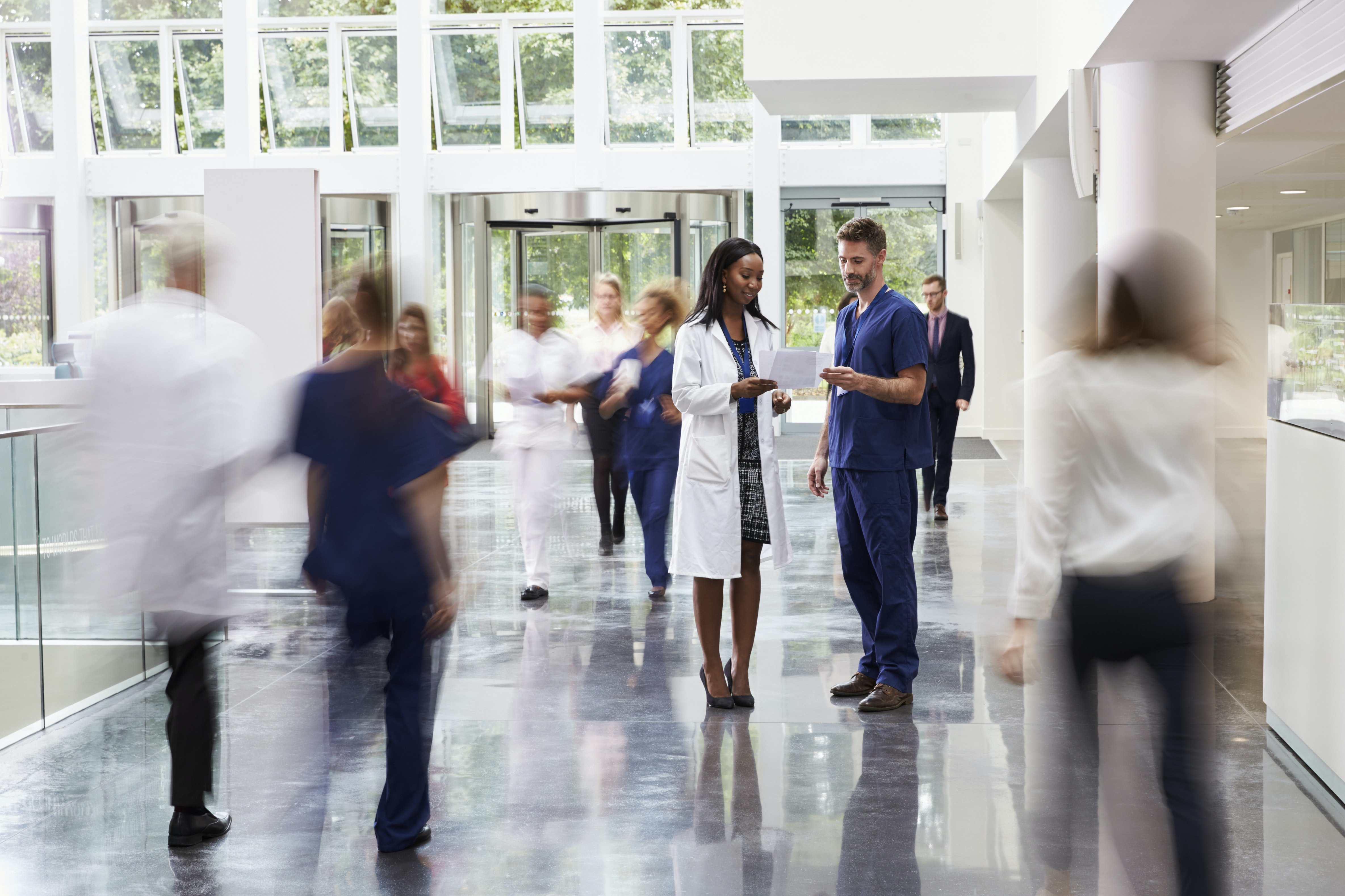 Personnel in the lobby of a busy hospital