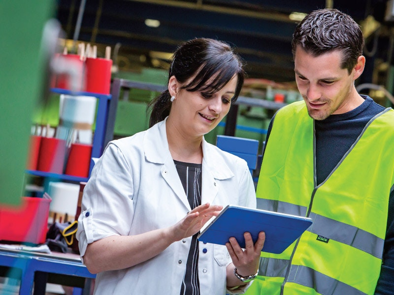 Safety inspectors in the workplace looking at tablet