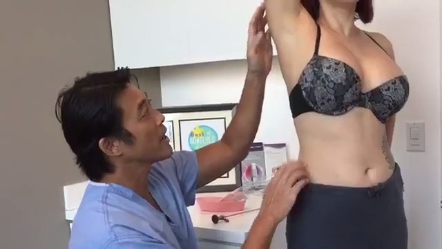 Dr. Shim Ching speaking with a breast augmentation patient