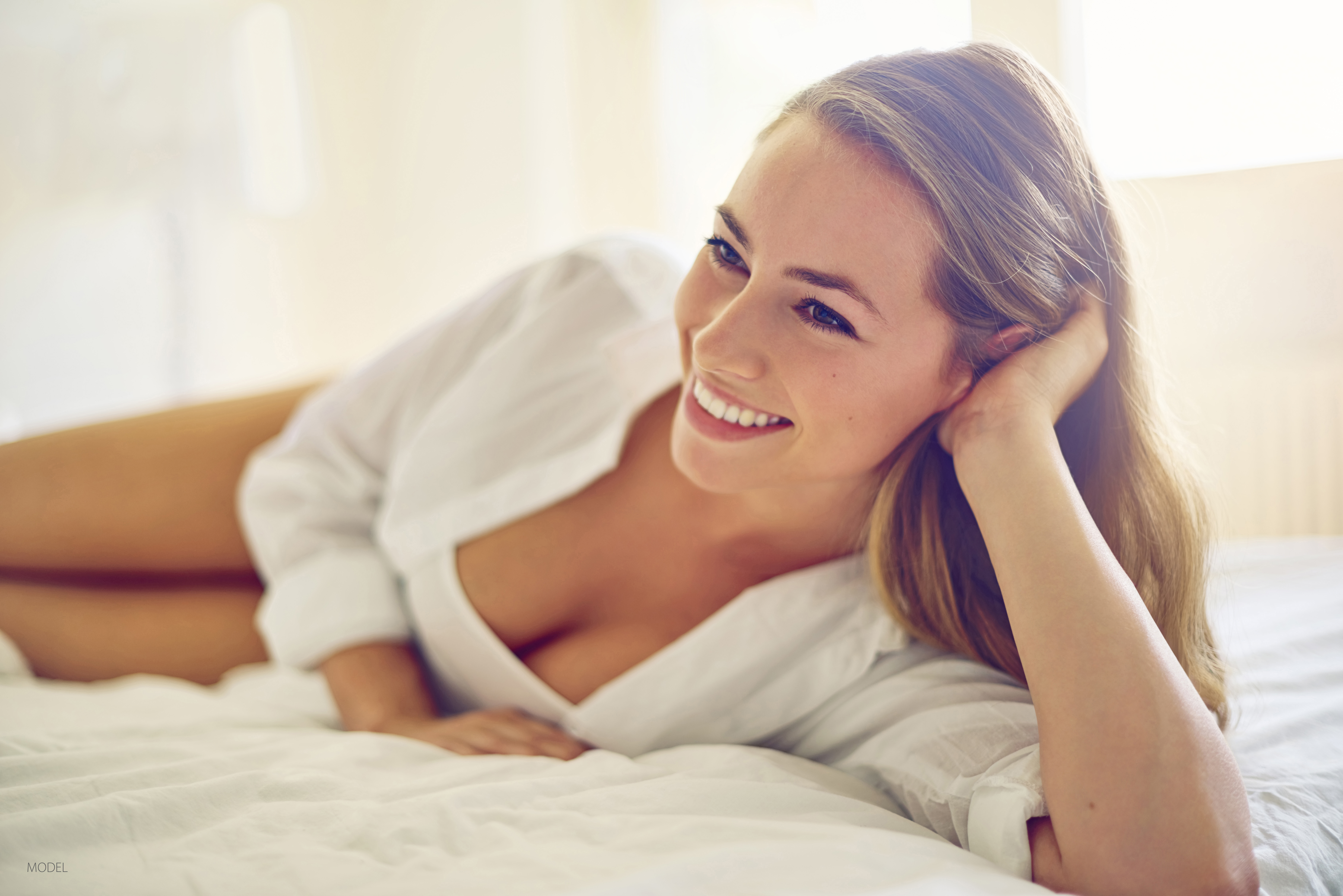 Learn about the unexpected benefits of breast augmentation