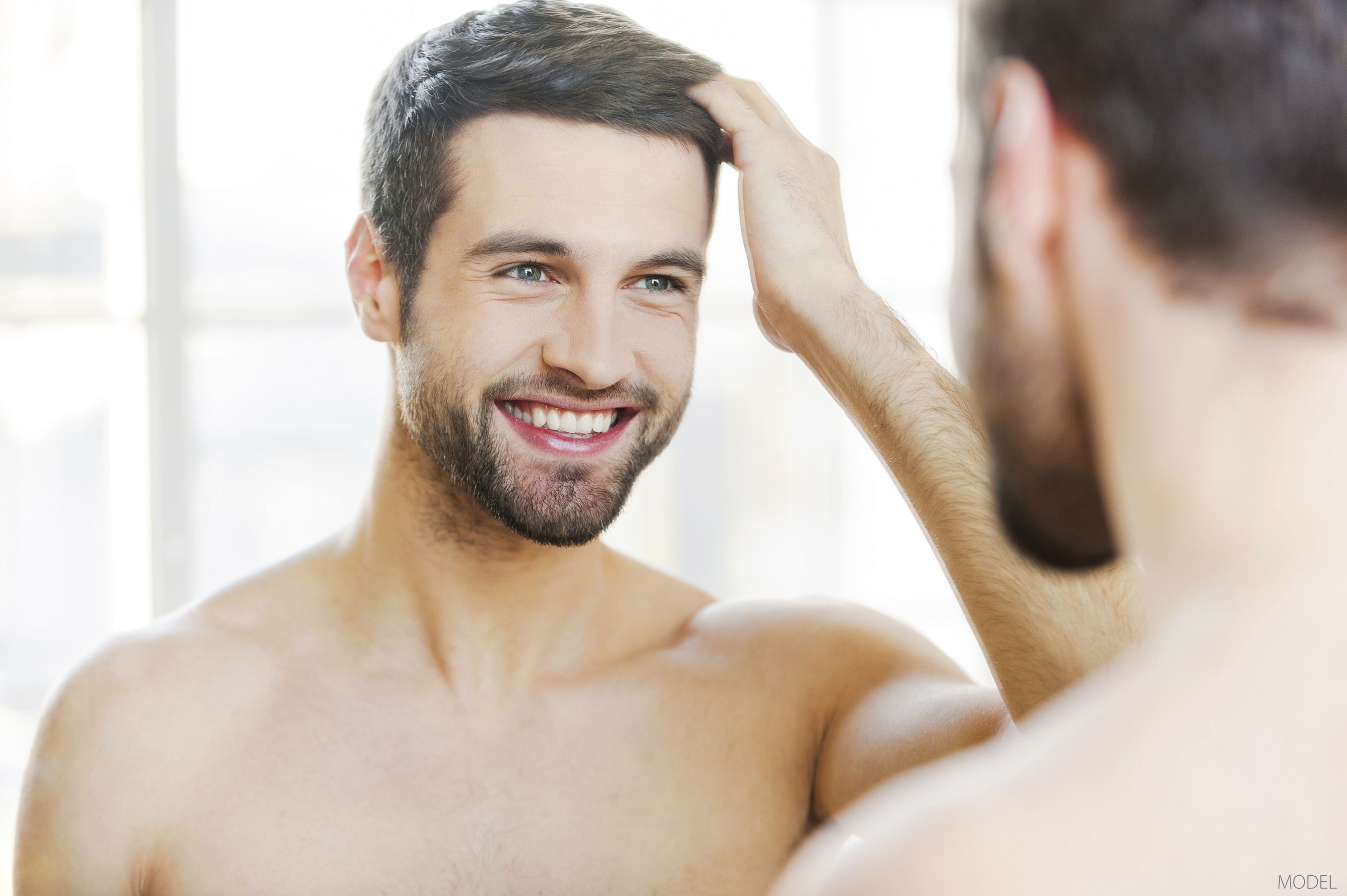 A patient is happy with his hair restoration results