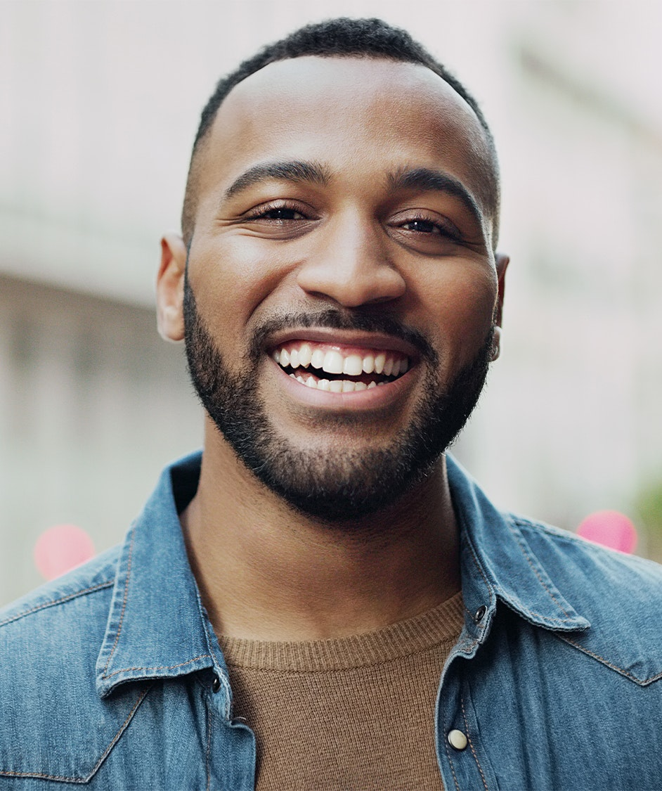 Handsome man smiling outside