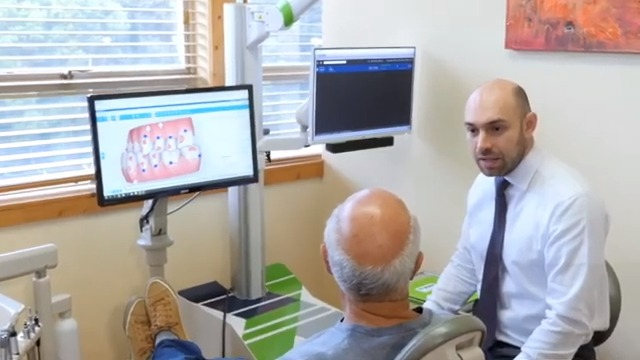 Dr. Samadian talking with a patient