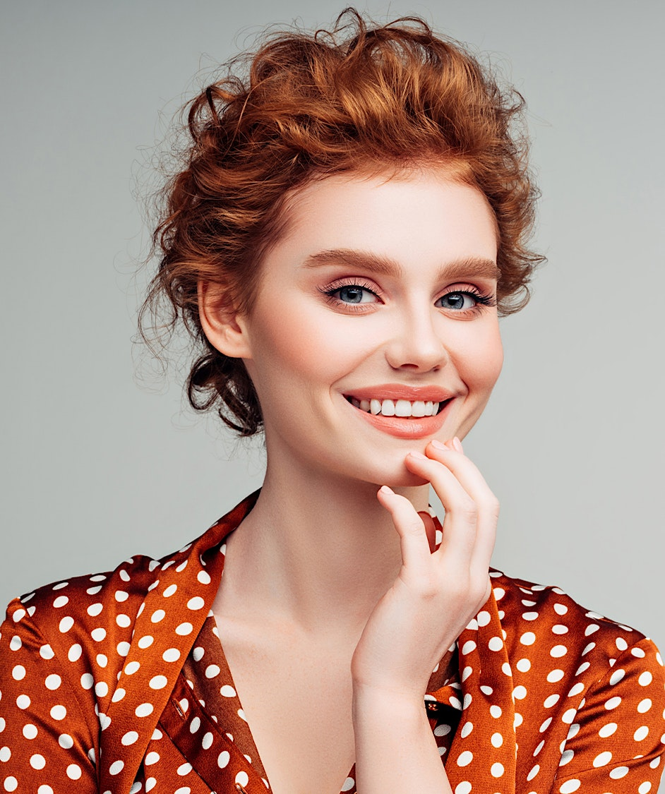 Beautiful woman with red hair smiling