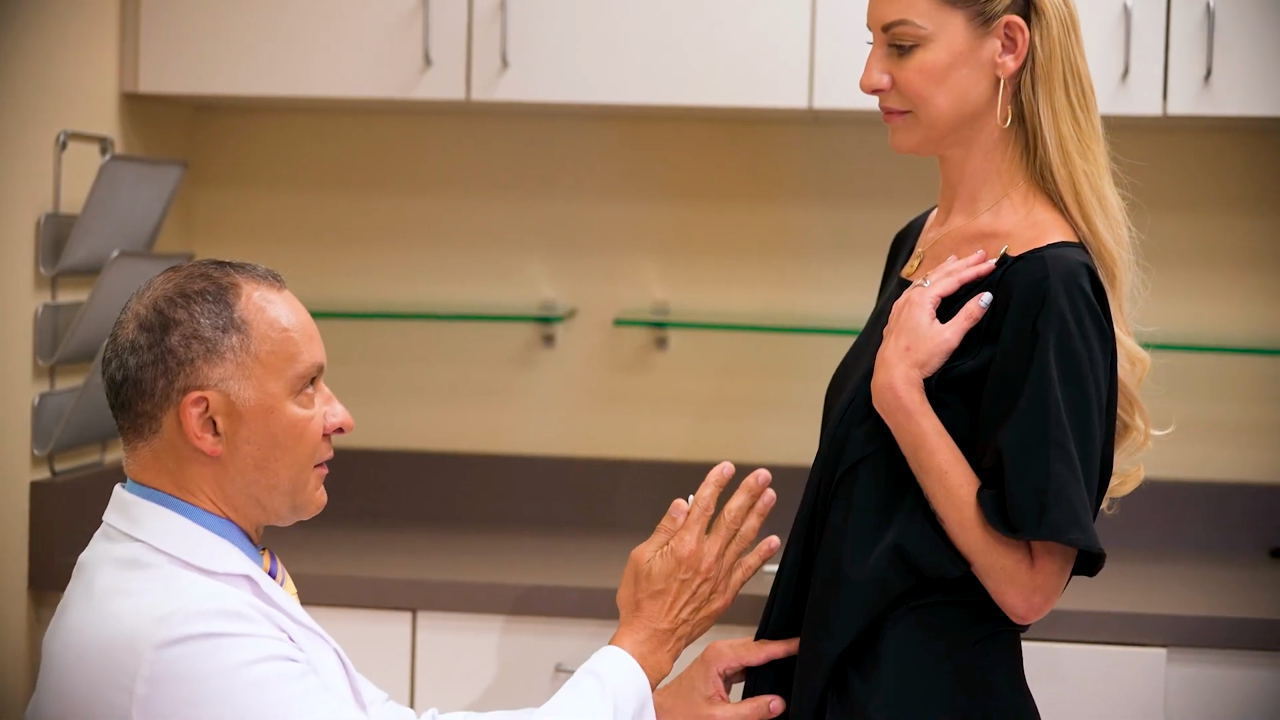 Dr. Delgado speaking with female patient about Mommy Makeover surgery in San Francisco