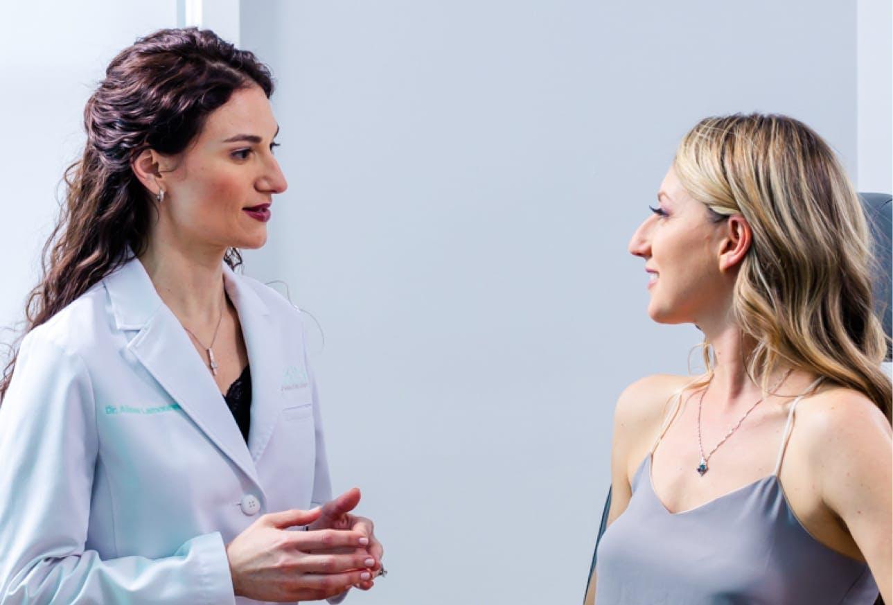 Dr. Lamoureux looking at a patient