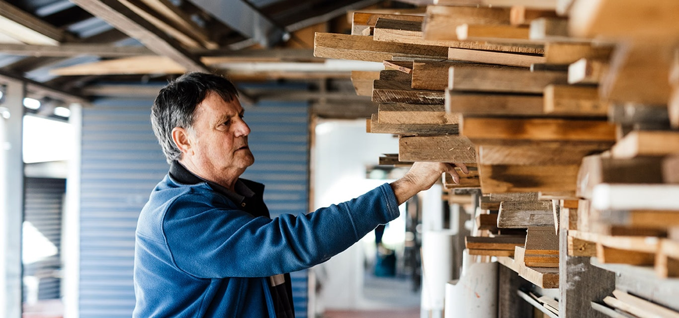 Man selecting timber for a project