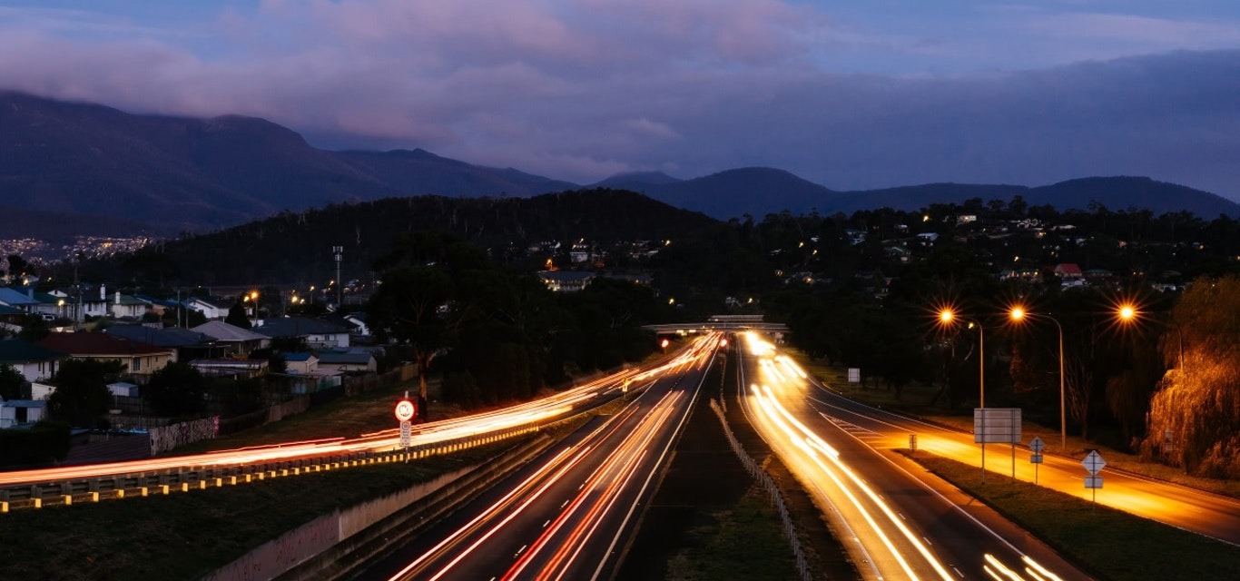 Hobart traffic on highway at night time - time lapse