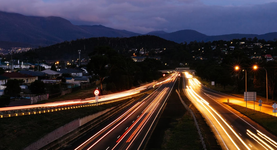 Time-lapse photo of the Tasman Highway at night time