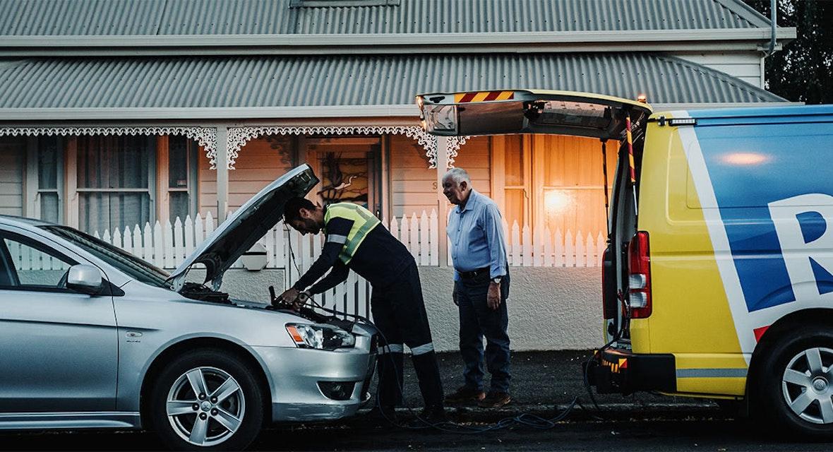 RACT Patrolman checking under the hood of a member's car