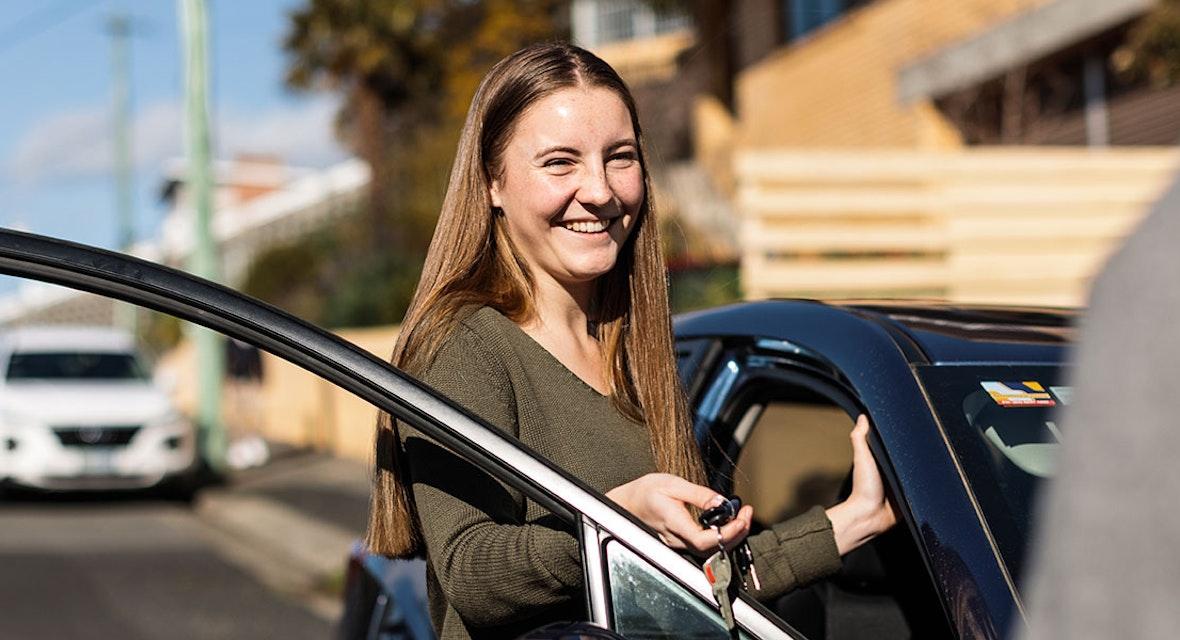 Learner driving getting car keys.
