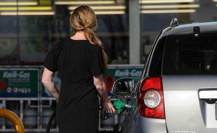 woman pumping fuel into car