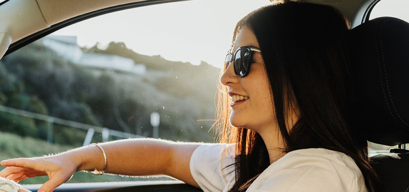 Young lady driving a car