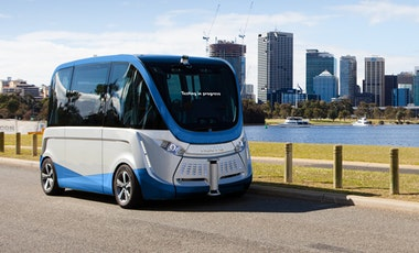 Self-driving electric vehicle in front of city