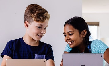 Children using their tablet devices.