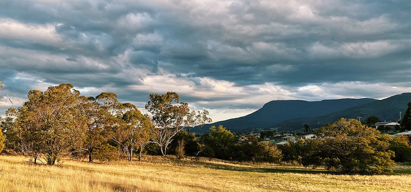 View of Mount Wellington from a distant field