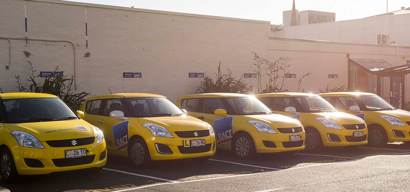 Line up of RACT Driver Training vehicles
