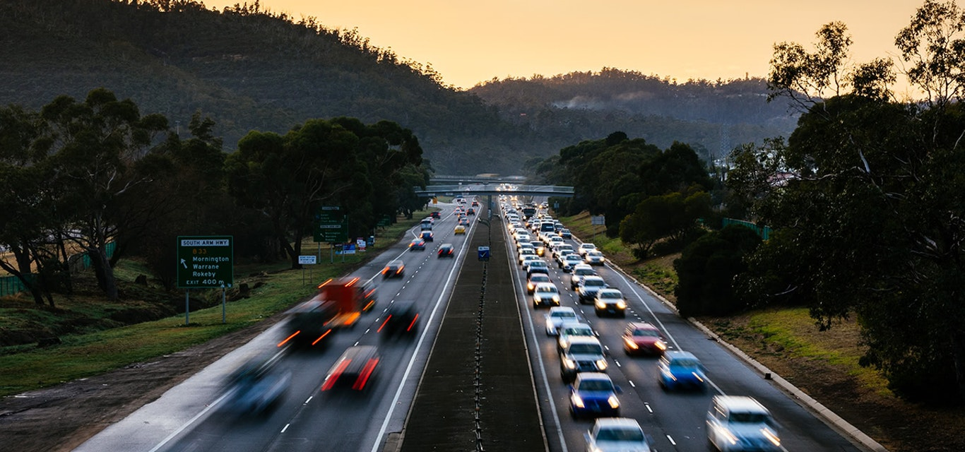 Cars travelling along Tasman Highway at dawn.