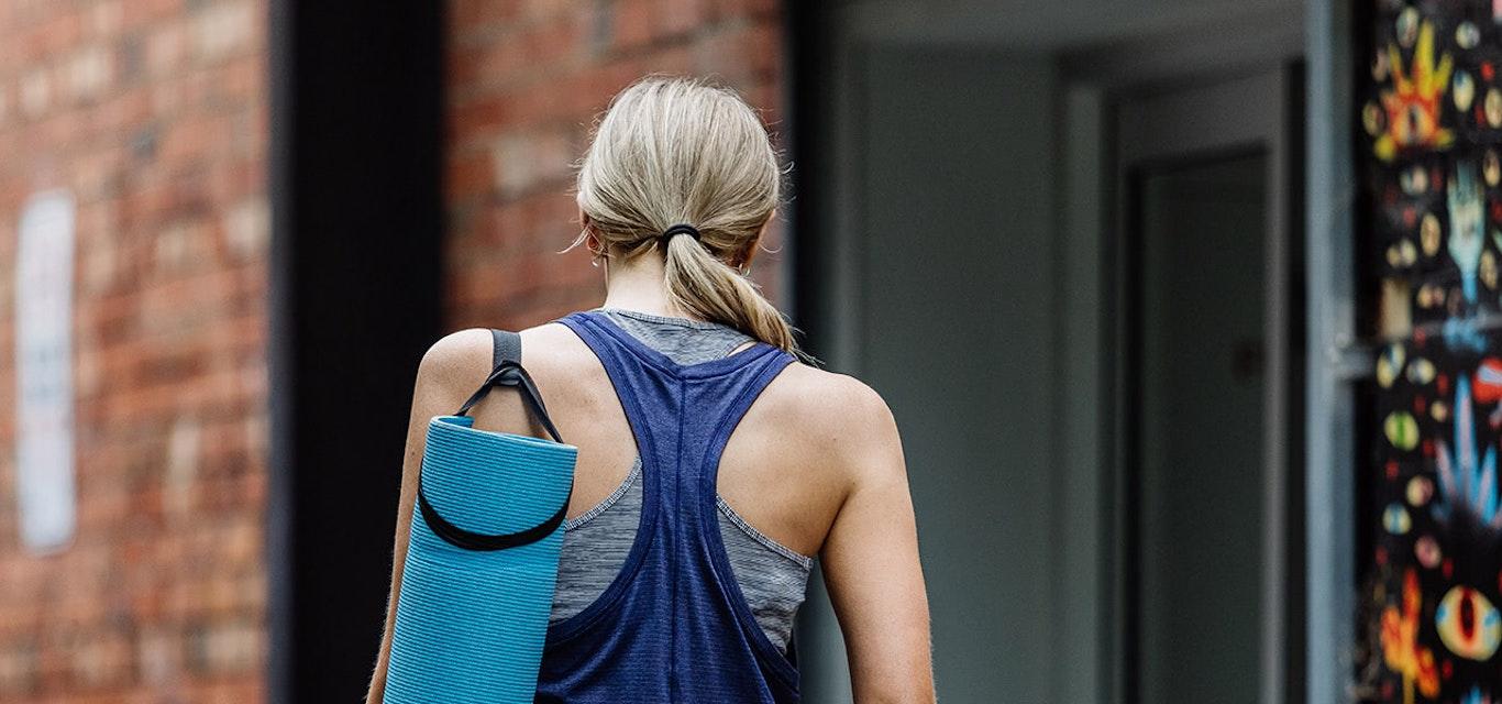 Woman going to yoga class