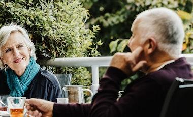 Older people enjoying beverage outside