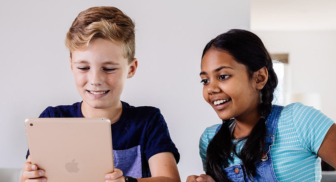 Two children looking at device