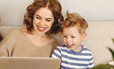 Mum and kids sitting around a laptop