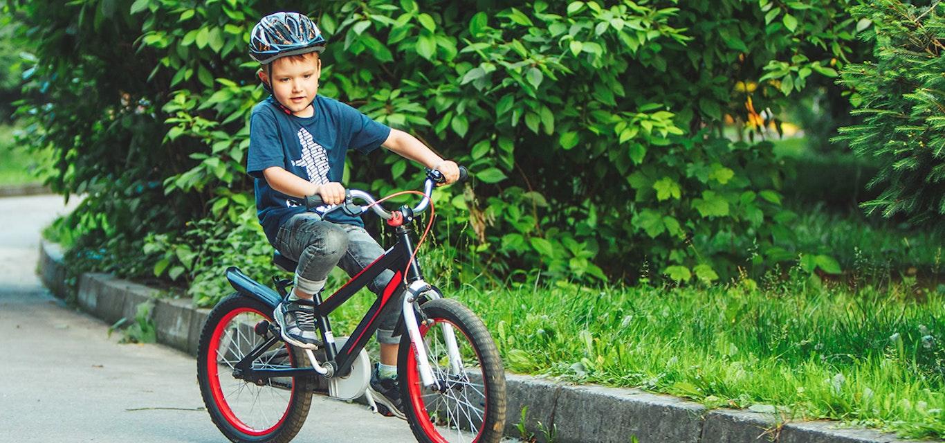 Young boy riding a small BMX bike
