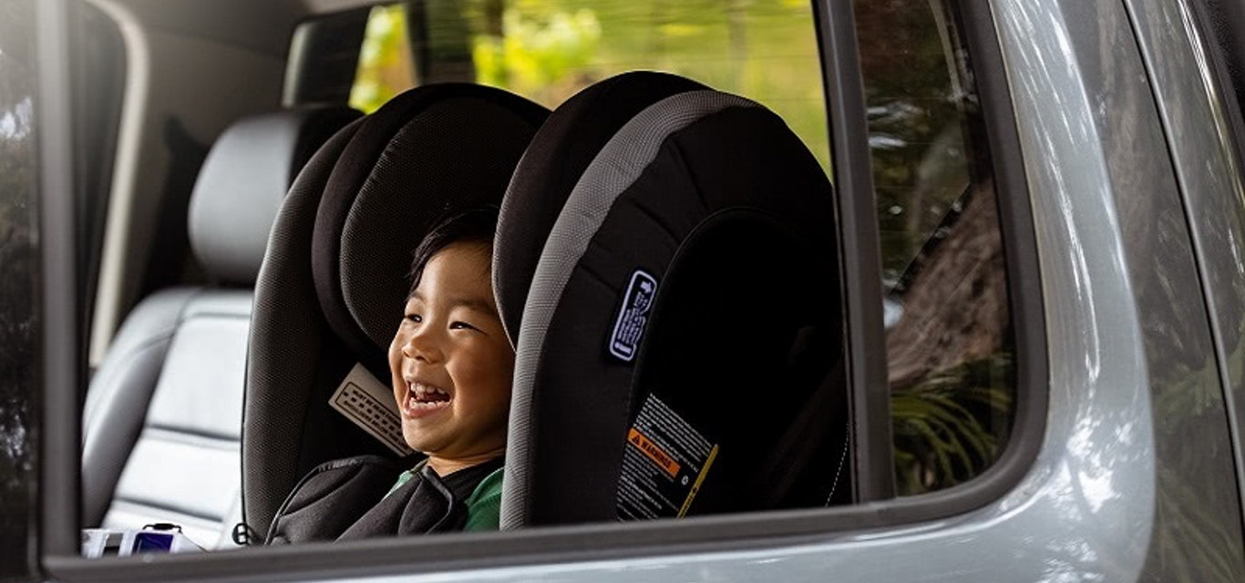 Child in back seat of car