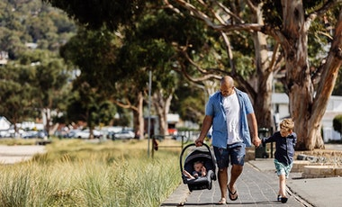 Dad with son and baby in carrier