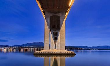 Underneath the Tasman Bridge looking back at Hobart City and Mount Wellington