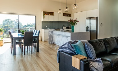 A spacious living room and kitchen