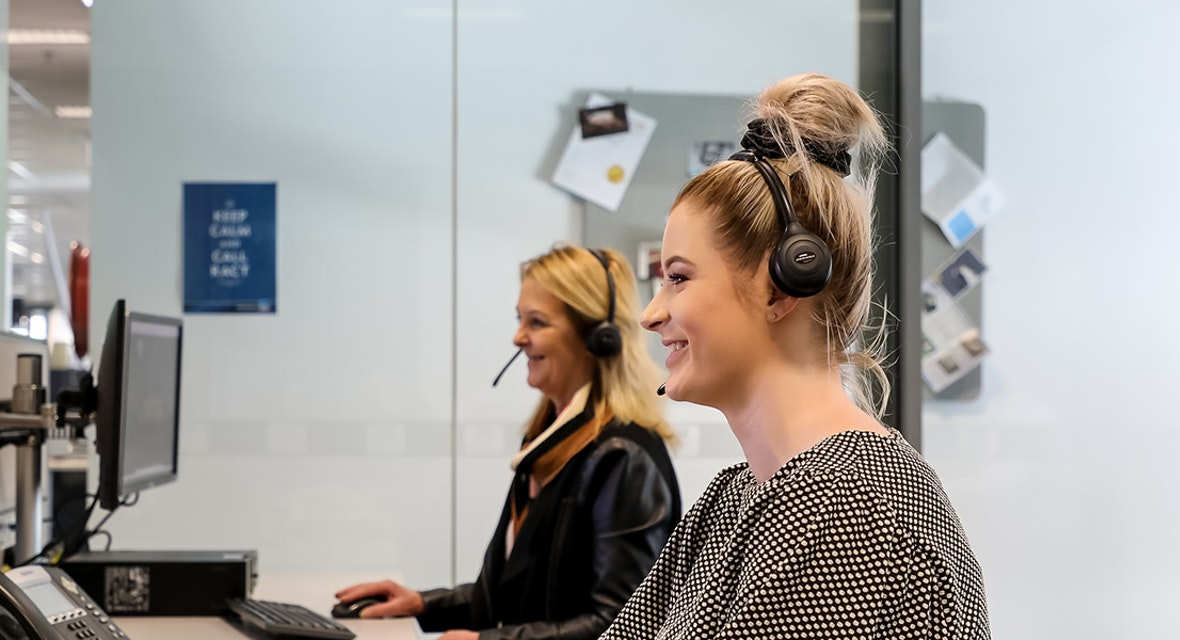 Customer service consultants helping members over the phone