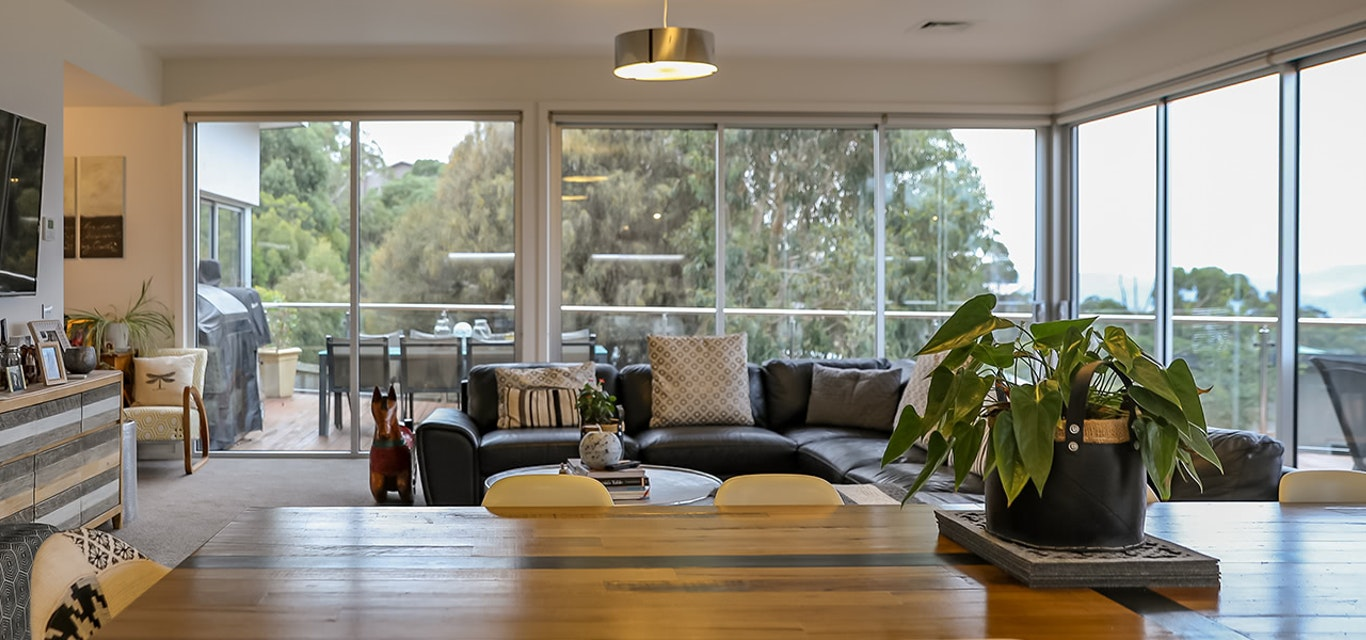 Image of a spacious living room with a nice view.