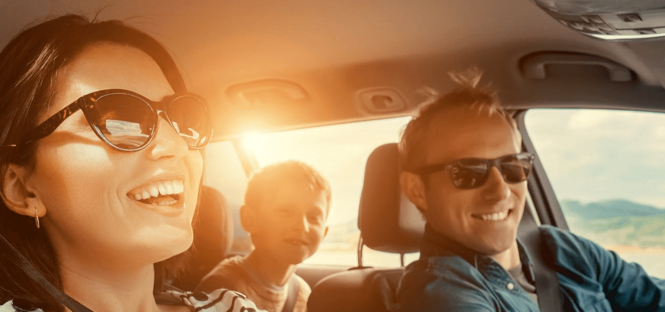 A happy family taking a road trip on a sunny day