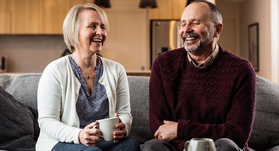 A couple having a coffee and a laugh