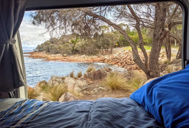 A view to a small bay from inside an Apollo campervan