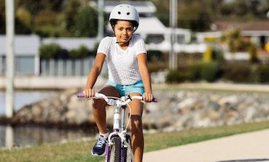 Girl riding bicycle.