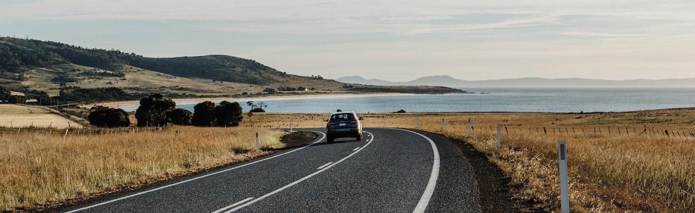 Car driving along coastal highway