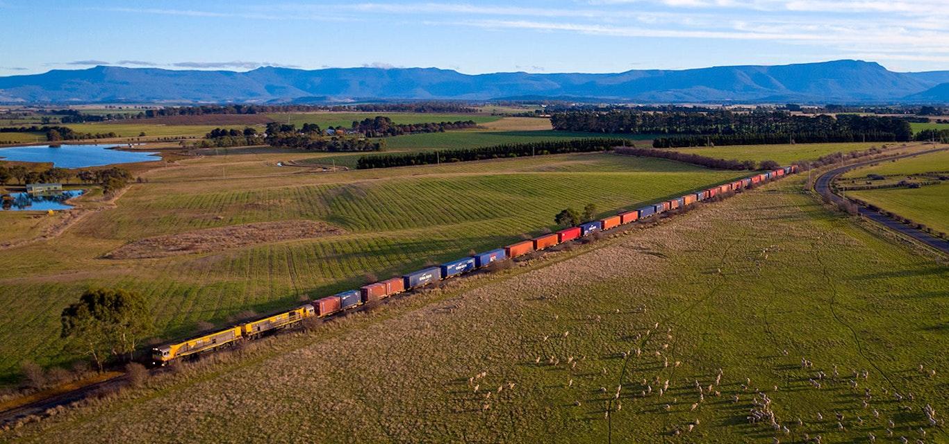 TasRail train crossing rural Tasmania