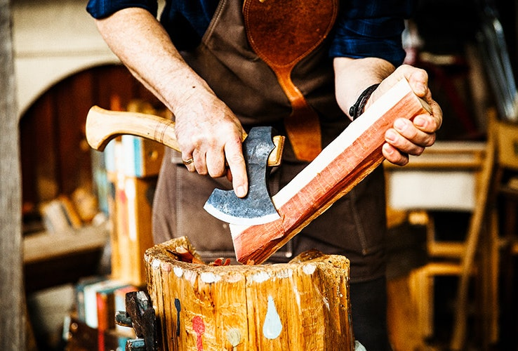 The beginnings of a wooden spoon made by hand with a carving axe
