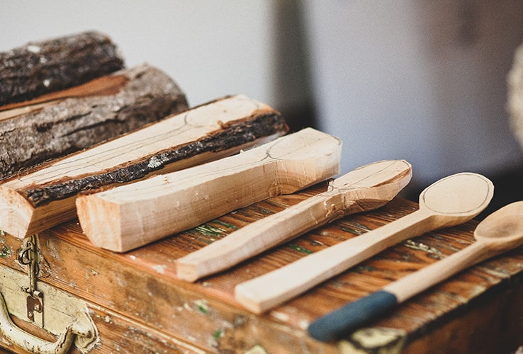 Wooden spoons at differing stages of creation