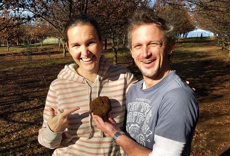 A couple holding a truffle