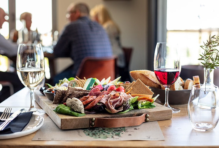 food on a platter with wine